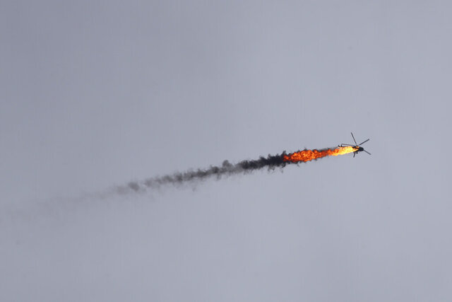 Syrian government helicopter is shot by a missile in Idlib province, Syria, Tuesday, Feb. 11, 2020. Syrian rebels shot down a government helicopter Tuesday in the country's northwest where Syrian troops are on the offensive in the last rebel stronghold. (AP Photo/Ghaith Alsayed)