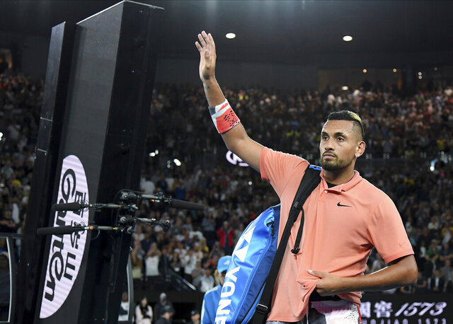 Australia's Nick Kyrgios waves after losing his their fourth round singles match to Spain's Rafael Nadal at the Australian Open tennis championship in Melbourne, Australia, Monday, Jan. 27, 2020. (AP Photo/Andy Brownbill)
