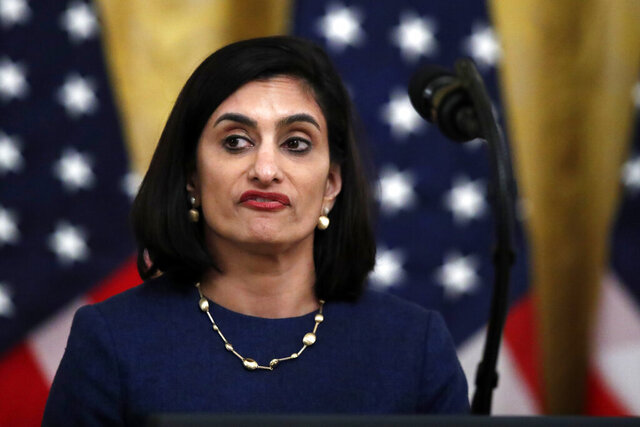 "FILE - In this April 30, 2020 file photo Administrator of the Centers for Medicare and Medicaid Services Seema Verma, speaks about protecting seniors, in the East Room of the White House in Washington. The head of the Medicare and Medicaid programs failed to properly manage more than $6 million in communications and outreach contracts, giving broad authority over federal employees to a Republican media strategist she worked with before joining the Trump administration, a government watchdog said in a report to be released Thursday.  Seema Verma, administrator of the Centers for Medicare and Medicaid Services, and other agency leaders did not administer the contracts ""in accordance with federal requirements,"" according to the inspector general at the Department of Health and Human Services. CMS is part of the department. (AP Photo/Alex Brandon)"