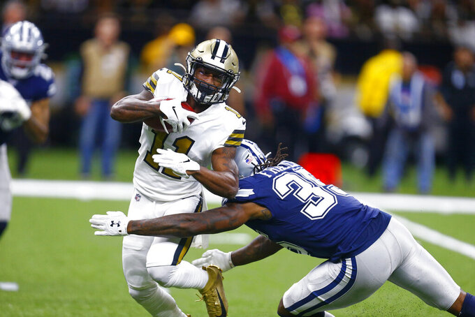 New Orleans Saints wide receiver Deonte Harris (11) carries against Dallas Cowboys free safety Kavon Frazier (35) on a kickoff return in the first half of an NFL football game in New Orleans, Sunday, Sept. 29, 2019. (AP Photo/Butch Dill)