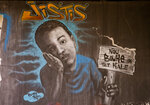 In this Feb. 12, 2020 photo, a mural shows a child with a sign that says in Creole: