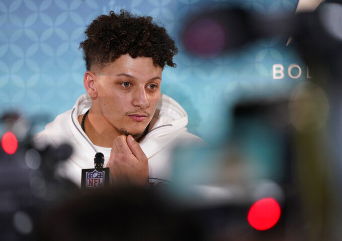 Kansas City Chiefs' Patrick Mahomes speaks to reporters during Opening Night for the NFL Super Bowl 54 football game Monday, Jan. 27, 2020, at Marlins Park in Miami. (AP Photo/David J. Phillip)