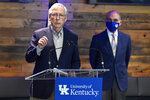 Senate Minority Leader Mitch McConnell, R-Ky., listens to a reporter's question during a news conference at a COVID-19 vaccination site in Lexington, Ky., Monday, April 5, 2021. In the background is University of Kentucky President Eli Capilouto. (AP Photo/Timothy D. Easley)