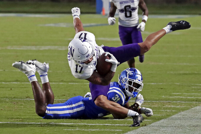 Northwestern wide receiver Bryce Kirtz (17) tumbles after being hit by Duke cornerback Josh Blackwell (31) during the second half of an NCAA college football game in Durham, N.C., Saturday, Sept. 18, 2021. (AP Photo/Chris Seward)