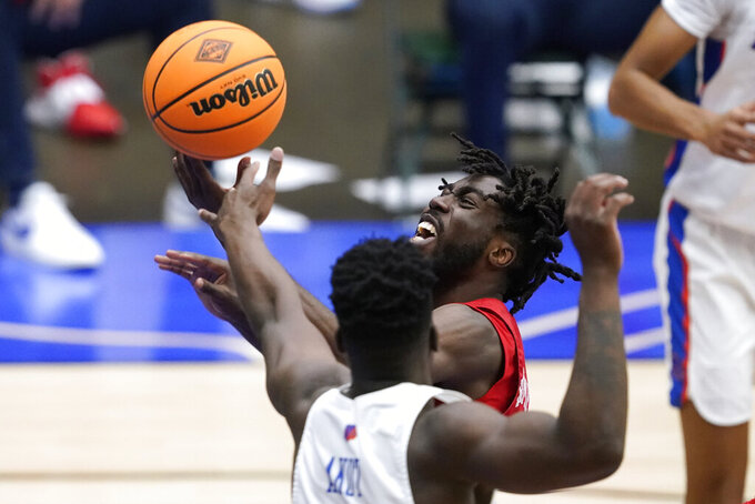 SMU guard Emmanuel Bandoumel is fouled by Boise State guard Emmanuel Akot (14) while driving to the basket during the second half of an NCAA college basketball game in the first round of the NIT, Thursday, March 18, 2021, in Frisco, Texas. (AP Photo/Tony Gutierrez)
