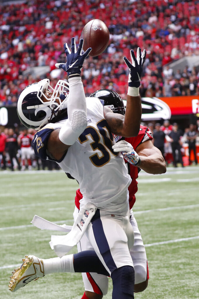 Los Angeles Rams running back Todd Gurley (30) makes a touchdown catch against the Atlanta Falcons during the first half of an NFL football game, Sunday, Oct. 20, 2019, in Atlanta. (AP Photo/John Bazemore)
