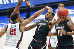 South Carolina's T.J. Moss (1) shoots around the reach of Mississippi's Robert Allen (21) in the second half of an NCAA college basketball game in the Southeastern Conference Tournament Thursday, March 11, 2021, in Nashville, Tenn. (AP Photo/Mark Humphrey)