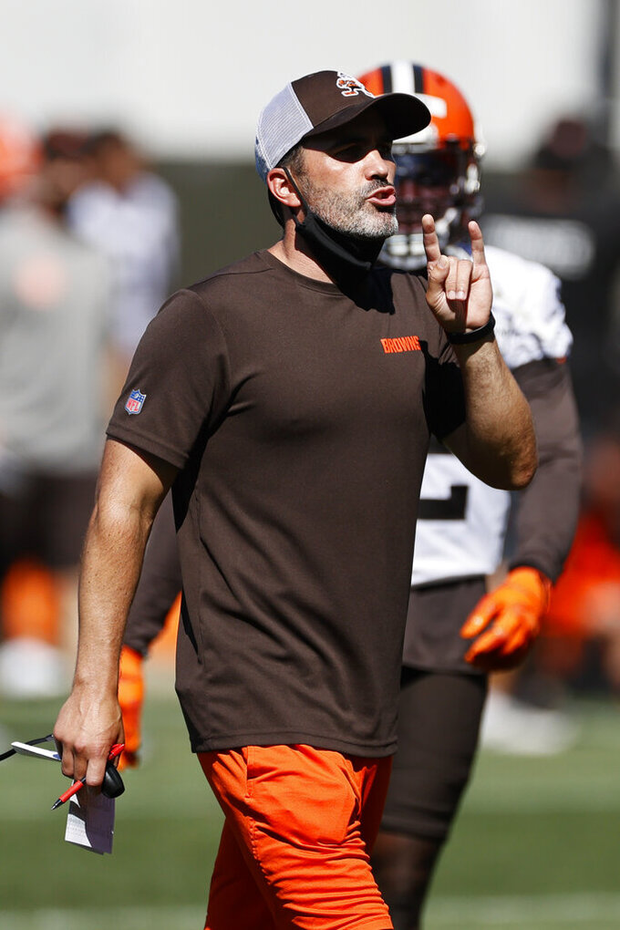 Cleveland Browns head coach Kevin Stefanski makes a call during practice at the NFL football team's training facility Thursday, Aug. 20, 2020, in Berea, Ohio. (AP Photo/Ron Schwane)