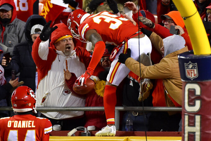 Kansas City Chiefs cornerback Charvarius Ward (35) celebrates with fans after he scored a safety against the Oakland Raiders on a blocked extra point-attempt in the second half of an NFL football game in Kansas City, Mo., Sunday, Dec. 1, 2019. (AP Photo/Ed Zurga)