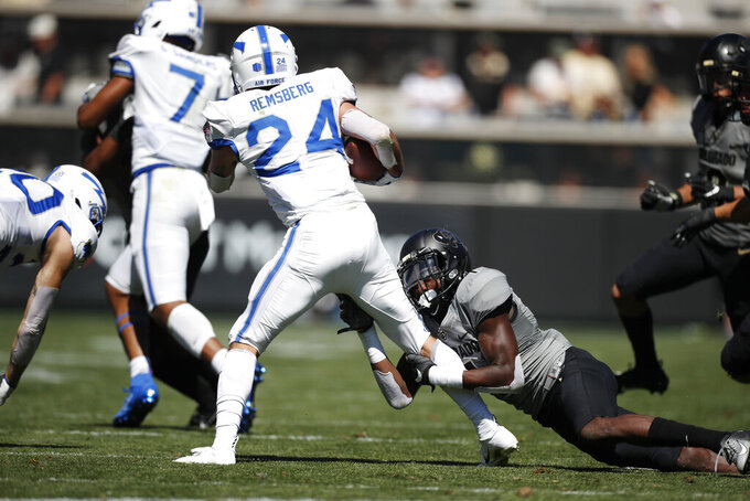Colorado cornerback Delrick Abrams Jr., right, stops Air Force running back Kadin Remsberg after a short gain in the second half of an NCAA college football game Saturday, Sept. 14, 2019, in Boulder, Colo. Air Force won 30-23 in overtime. (AP Photo/David Zalubowski)