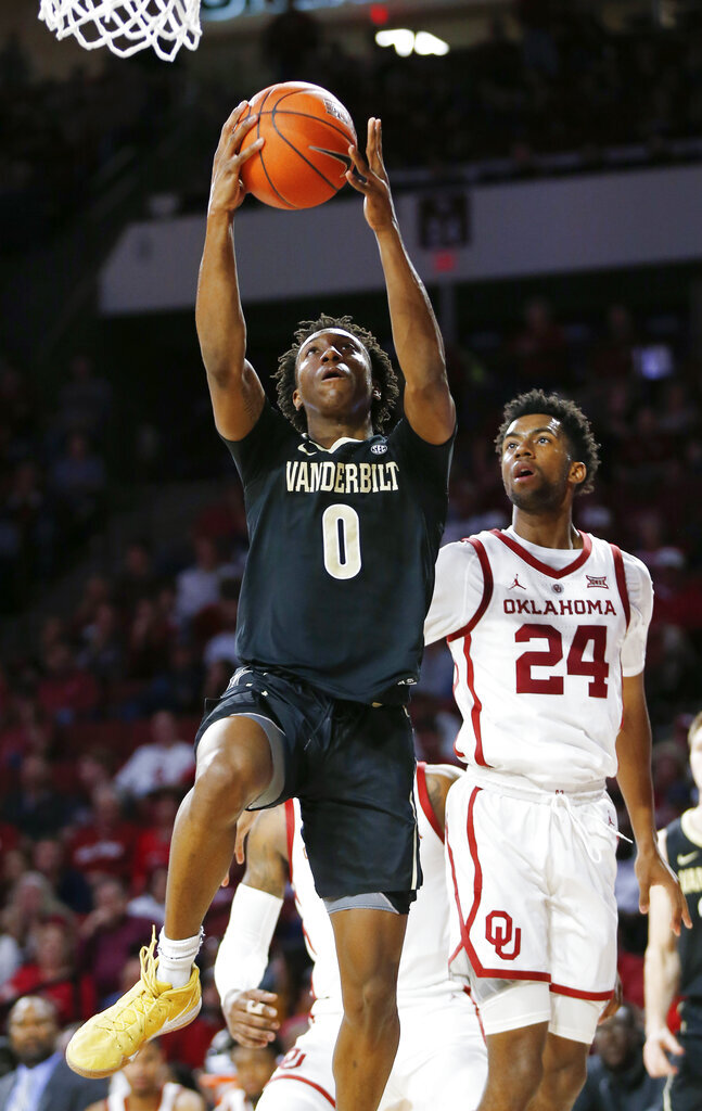 Vanderbilt's Saben Lee (0) takes the ball to the basket in front of Oklahoma's Jamal Bieniemy (24) during the first half of an NCAA college basketball game in Norman, Okla., Saturday, Jan. 26, 2019. (Nate Billings/The Oklahoman via AP)