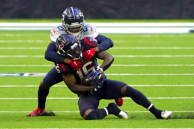Houston Texans wide receiver Keke Coutee (16) is tackled by Tennessee Titans cornerback Malcolm Butler (21) during the first half of an NFL football game Sunday, Jan. 3, 2021, in Houston. (AP Photo/Eric Christian Smith)