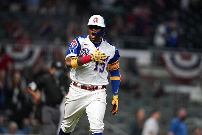 Atlanta Braves' Ronald Acuna Jr. celebrates his home run during the seventh inning of the team's baseball game against the Miami Marlins on Wednesday, April 14, 2021, in Atlanta. (AP Photo/Brynn Anderson)