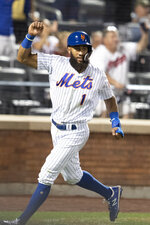New York Mets' Amed Rosario scores during the 10th inning of the team's baseball game against the Cleveland Indians on Wednesday, Aug. 21, 2019, in New York. (AP Photo/Mary Altaffer)