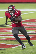 Tampa Bay Buccaneers running back LeSean McCoy (25) carries the ball during warm-ups prior to an NFL game against the New Orleans Saints, Sunday, Nov. 8, 2020 in Tampa, Fla. The Saints defeated the Buccaneers 38-3. (Margaret Bowles via AP)