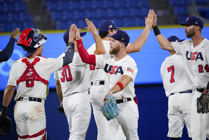 Team United States celebrate their win after a baseball game against South Korea at the 2020 Summer Olympics, Saturday, July 31, 2021, in Yokohama, Japan. United States won 4-2. (AP Photo/Sue Ogrocki)