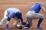 Kansas City Royals Nicky Lopez, left, beats the tag by Toronto Blue Jays second baseman Joe Panik, right, during the second inning of a baseball game at Kauffman Stadium in Kansas City, Mo., Sunday, April 18, 2021. Lopez was safe with a stolen base on the play. (AP Photo/Orlin Wagner)