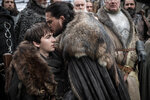 This image released by HBO shows  Isaac Hempstead Wright, left, and Kit Harington in a scene from