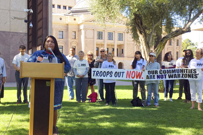 Amy Juan, a resident of the Tohono O'odham Nation in Arizona, speaks out against the military's presence at the U.S.-Mexico border in Phoenix Thursday, Nov. 8, 2018. Residents of border communities in the Southwest say they oppose President Donald Trump's deployment of thousands of troops to the border in response to a caravan of Central American migrants headed for the U.S. (AP Photo/Astrid Galvan)