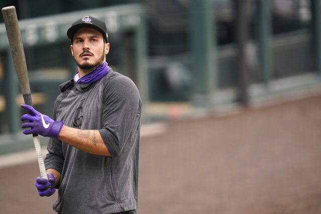 Colorado Rockies' Nolan Arenado warms up before a baseball game against the Los Angeles Dodgers, Saturday, Sept. 19, 2020, in Denver. (AP Photo/David Zalubowski)