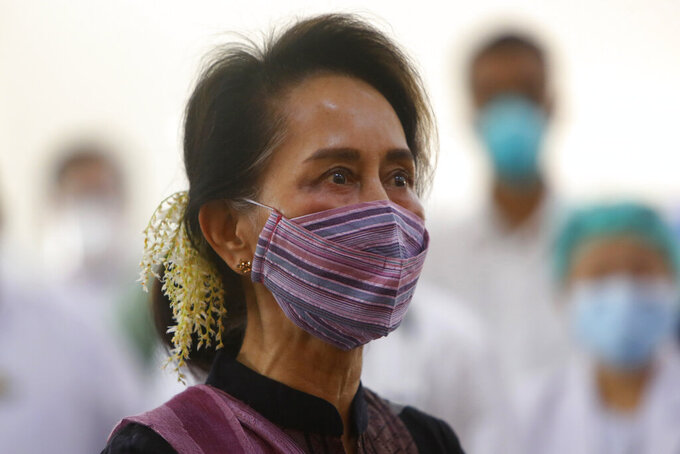 FILE - In this Jan 27, 2021, file photo, Myanmar leader Aung San Suu Kyi watches the vaccination of health workers at hospital in Naypyitaw, Myanmar. A court in Myanmar ruled Tuesday that the trial on charges of incitement of ousted national leader Aung San Suu Kyi and two of her political allies proceed to its substantive second phase, in which the defendants can present their case. Suu Kyi and her elected government were ousted by a military takeover in February. (AP Photo/Aung Shine Oo, File)