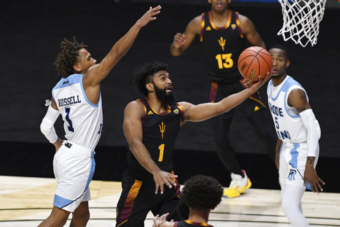 Arizona State's Remy Martin goes up for a basket as Rhode Island's Fatts Russell, left, defends during the first half of an NCAA college basketball game Wednesday, Nov. 25, 2020, in Uncasville, Conn. (AP Photo/Jessica Hill)