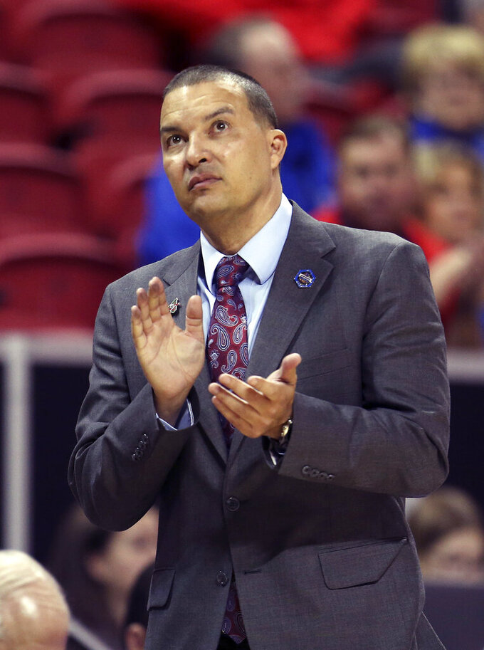 Fresno State head coach Justin Hutson claps during the second half of an NCAA college basketball game against Air Force in the Mountain West Conference men's tournament Thursday, March 14, 2019, in Las Vegas. (AP Photo/Isaac Brekken)