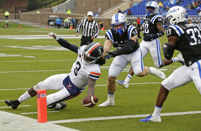 FILE - In this Oct. 20, 2018, file photo, Virginia quarterback Bryce Perkins (3) runs for a touchdown while Duke linebacker Ben Humphreys (34) chases during the first half of an NCAA college football game, in Durham, N.C. Virginia plays North Carolina on Saturday, Oct. 27. (AP Photo/Gerry Broome, File)
