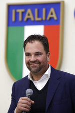 Hall of Fame catcher Mike Piazza speaks during his presentation as Italy's national baseball team coach, at the Italian Olympic Committee headquarters in Rome, Friday, Nov. 29, 2019. (AP Photo/Alberto Pellaschiar)