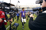 FILE - In this Jan. 6, 2019, file photo, Baltimore Ravens quarterback Lamar Jackson (8) walks off the field after an NFL wild card playoff football game against the Los Angeles Chargers, in Baltimore. Greg Roman is off to a running start in his new role as offensive coordinator of the Baltimore Ravens, working on a ground game that will coincide with the skills of agile quarterback Lamar Jackson. (AP Photo/Nick Wass, File)