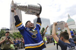 FILE - St. Louis Blues left wing Pat Maroon lifts the Stanley Cup during the NHL hockey Stanley Cup victory celebration in St. Louis, in this Saturday, June 15, 2019, file photo. Maroon would become the fourth player in NHL history and first since 1964 to win the Stanley Cup three seasons in a row as long as the Tampa Bay Lightning finish off the Montreal Canadiens in the final. The St. Louis native helped his hometown Blues win the Cup in 2019 for their first title in franchise history and was with the Lightning when they won last fall in the bubble. (AP Photo/Scott Kane, File)