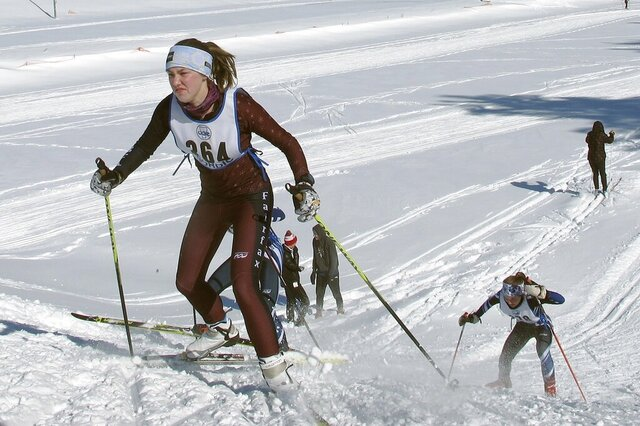 In this Feb. 8, 2020, photo, cross-country skiers from around Vermont compete in races at U-32 Middle & High School in East Montpelier, Vt. The ski racing community worldwide is starting to back away from the use of fluorinated waxes that contain chemicals that pose threats to human health and impact the environment. (AP Photo/Lisa Rathke)