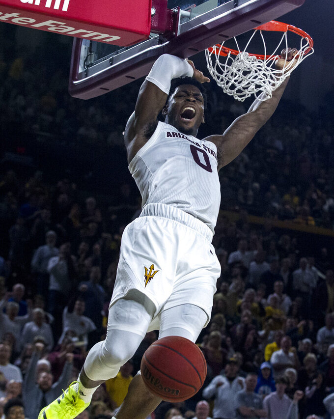 Arizona State's Luguentz Dort (0) dunks against Oregon during the second half of an NCAA college basketball game Saturday, Jan. 19, 2019, in Tempe, Ariz. Arizona State won 78-64. (AP Photo/Darryl Webb)