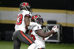 Tampa Bay Buccaneers inside linebacker Devin White, right, celebrates after his interception with cornerback Sean Murphy-Bunting (23) against the New Orleans Saints during the second half of an NFL divisional round playoff football game, Sunday, Jan. 17, 2021, in New Orleans. (AP Photo/Butch Dill)