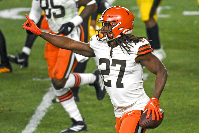 Cleveland Browns running back Kareem Hunt (27) celebrates after scoring on an eight-yard run during the first half of an NFL wild-card playoff football game against the Pittsburgh Steelers in Pittsburgh, Sunday, Jan. 10, 2021. (AP Photo/Don Wright)