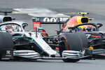 Mercedes driver Lewis Hamilton of Britain, front, steers his car followed by Red Bull driver Pierre Gasly of France during the third free practice at the Silverstone racetrack, in Silverstone, England, Saturday, July 13, 2019. The British Formula One Grand Prix will be held on Sunday. (AP Photo/Luca Bruno)