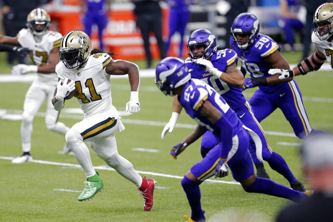 New Orleans Saints running back Alvin Kamara (41) breaks free past Minnesota Vikings cornerback Cameron Dantzler (27), outside linebacker Eric Wilson (50) and defensive end D.J. Wonnum (98) on a 40 year touchdown carry in the first half of an NFL football game in New Orleans, Friday, Dec. 25, 2020. (AP Photo/Brett Duke)