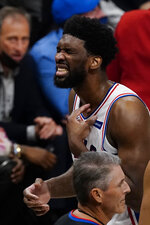 Philadelphia 76ers center Joel Embiid, top right, reacts after being injured during the second half of Game 6 of an NBA basketball Eastern Conference semifinal series against the Atlanta Hawks, Friday, June 18, 2021, in Atlanta. Embiid reminded in the game. (AP Photo/John Bazemore)