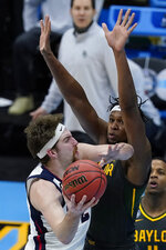 Gonzaga forward Drew Timme, left, shoots over Baylor forward Flo Thamba during the first half of the championship game in the men's Final Four NCAA college basketball tournament, Monday, April 5, 2021, at Lucas Oil Stadium in Indianapolis. (AP Photo/Darron Cummings)