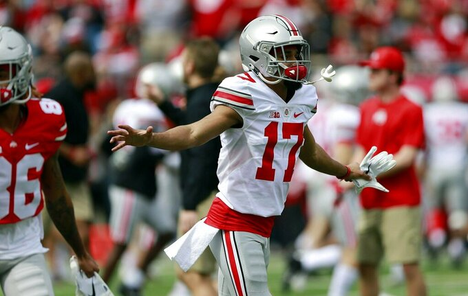 Ohio State's Chris Olave (17) runs during warmups before the spring NCAA college football game at the Ohio Stadium in Columbus, Ohio, Saturday April 13, 2019. (Brooke LaValley/The Columbus Dispatch via AP)