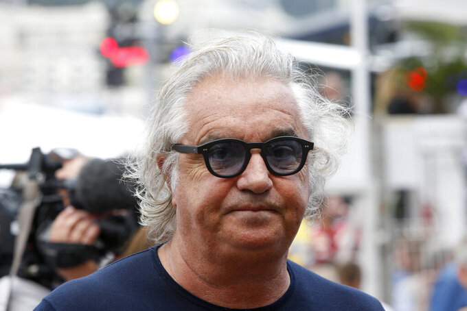 Former F1 Renault Team principal Flavio Briatore attends the Formula One Grand Prix, at the Monaco racetrack, in Monaco, Sunday, May 24, 2015. On Tuesday Aug. 25, 2020, Briatore has reportedly been admitted to hospital in Milan with coronavirus, there has been no official statement from the hospital but multiple reports say Briatore's condition is serious but he is not in intensive care.  (AP Photo/Luca Bruno)