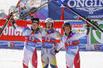 Norway's Lucas Braathen, center, winner of alpine ski, men's World Cup giant slalom, poses with second placed Switzerland's Marco Odermatt, left, and third placed Switzerland's Gino Caviezel, in Soelden, Austria, Sunday, Oct. 18, 2020. (AP Photo/Giovanni Auletta)