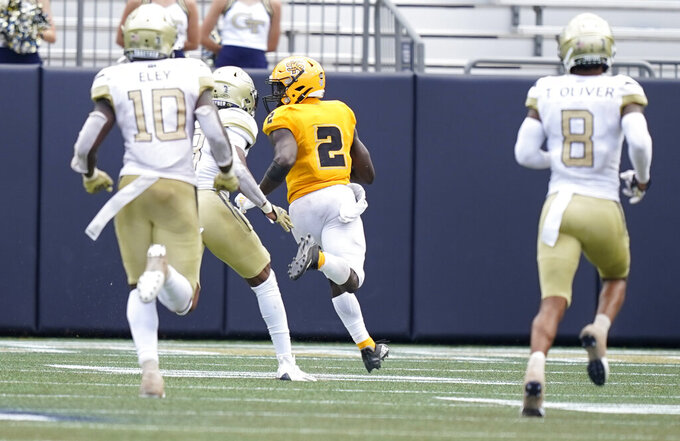 Kennesaw State running back Adeolu Adeleke (2) scores a touchdown during the second half of an NCAA college football game against Georgia Tech, Saturday, Sept. 11, 2021, in Atlanta. (AP Photo/Brynn Anderson)