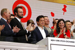 Pinterest co-founder & CEO Ben Silbermann, center, and fellow co-founder and chief product officer Evan Sharp, second left, ring the New York Stock Exchange opening bell, Thursday, April 18, 2019, before the company's IPO. At right is NYSE President Stacey Cunningham. (AP Photo/Richard Drew)
