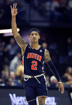 Auburn's Bryce Brown celebrates after making a 3-point basket in the second half of the NCAA college basketball Southeastern Conference championship game against Tennessee Sunday, March 17, 2019, in Nashville, Tenn. (AP Photo/Mark Humphrey)