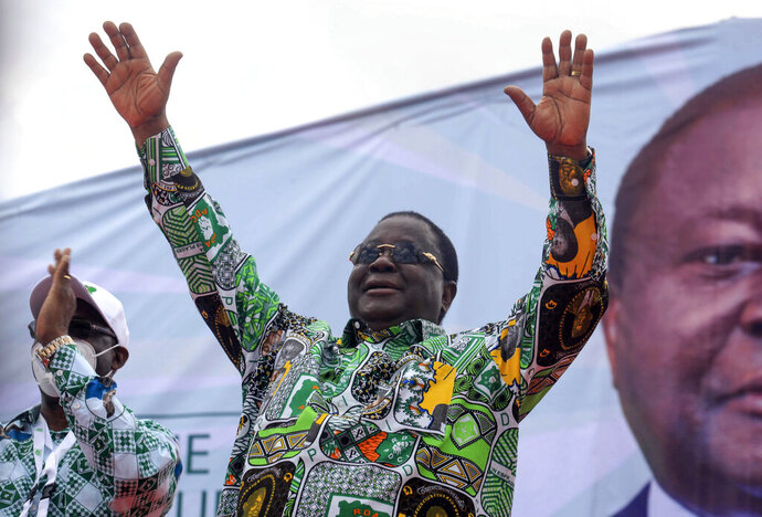 Former president Henri Konan Bedie, 86, gestures to supporters at a party rally to celebrate his presidential candidacy for the opposition PDCI-RDA party and as a show of strength ahead of next months presidential election, in Yamoussoukro, Ivory Coast Saturday, Sept. 12, 2020. Bedie, who led the country from 1993-1999, and Pascal Affi N'Guessan of the Ivorian Popular Front party, are the two opposition leaders who pose the strongest threat to incumbent President Alassane Ouattara. (AP Photo/Diomande Ble Blonde)