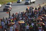 Members of Minnesota's Oromo community shut down westbound Interstate 94 on Wednesday, July 1, 2020, in St. Paul, Minn. Protesters apparently outraged by the killing of Hachalu Hundessa, a popular singer in Ethiopia, stopped traffic on the interstate during the evening rush hour. Police blocked the entrance ramps to the freeway shortly before 6:30 p.m. Traffic was stopped as the group moved down the interstate. State Patrol spokesman Lt. Gordon Shank said after 8 p.m. the protesters had left the freeway, and no arrests have been made. (Christine T. Nguyen/Minnesota Public Radio via AP)