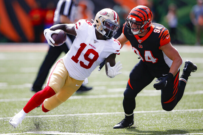 San Francisco 49ers wide receiver Deebo Samuel (19) runs against Cincinnati Bengals defensive end Sam Hubbard (94) during the first half an NFL football game, Sunday, Sept. 15, 2019, in Cincinnati. (AP Photo/Gary Landers)