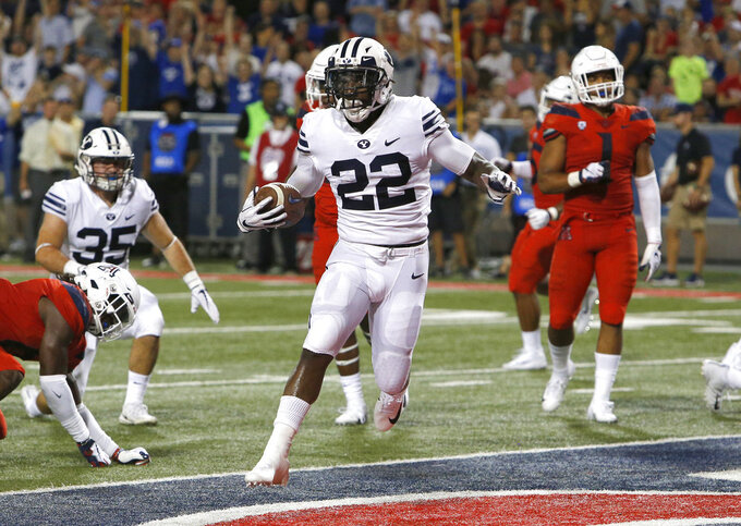 Brigham Young running back Squally Canada (22) scores a touchdown against Arizona in the second half during an NCAA college football game, Saturday, Sept. 1, 2018, in Tucson, Ariz. BYU defeated Arizona 28-23. (AP Photo/Rick Scuteri)