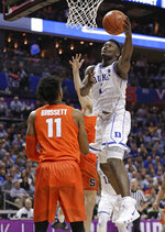 Duke's Zion Williamson (1) drives against Syracuse's Oshae Brissett (11) during the first half of an NCAA college basketball game in the Atlantic Coast Conference tournament in Charlotte, N.C., Thursday, March 14, 2019. (AP Photo/Nell Redmond)